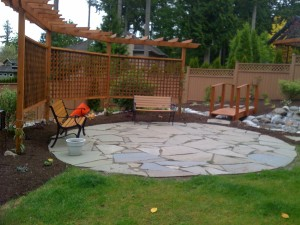Patio bridge pergola water feature - Ladybug Landscaping Ltd