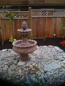 Water feature installation in South Surrey: AFTER  - Ladybug Landscaping Ltd
