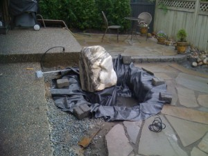 Water feature installation in progress in South Surrey - Ladybug Landscaping Ltd